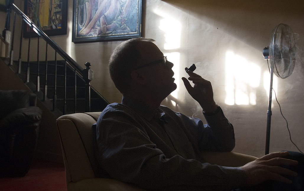 J.D. Talasek smoking in his favorite cigar lounge.