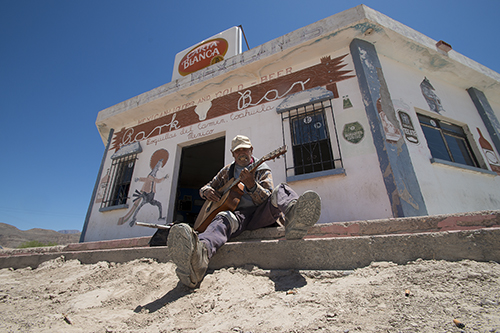 Juaquin Luna, 83, plays guitar outside the cantina in Boquillas, Coahuila, Mexico on April 19, 2013.