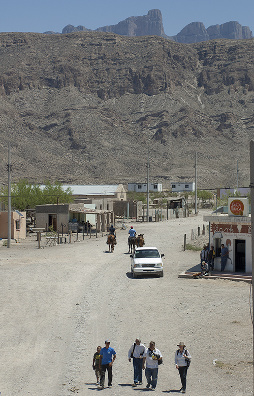 American tourists stroll the main road in Boquillas on April 20, 2013 just nine days after the border crossing was re-opened between the village and Rio Grande Village in Big Bend National Park in Texas.
