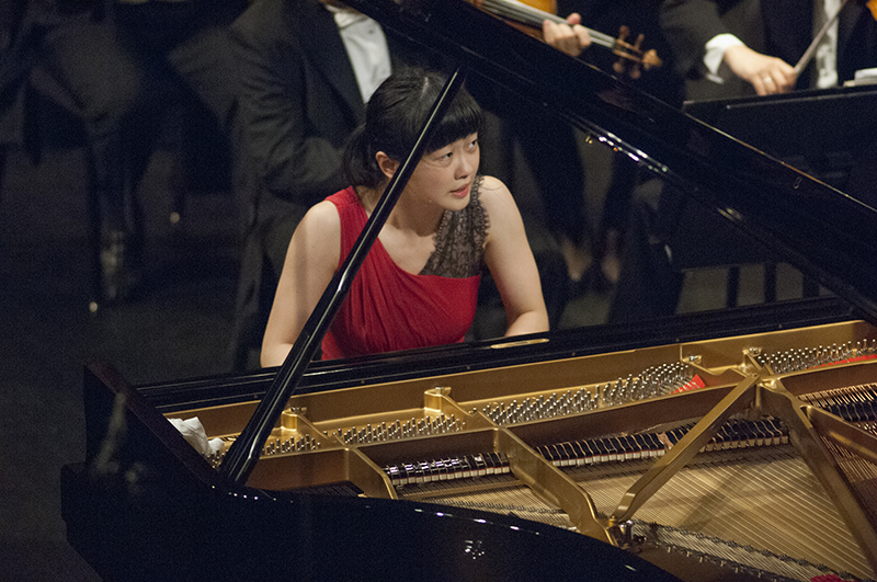 Chinese pianist Fei-Fei Dong glances up at conductor Leonard Slatkin during her performance of Rachmaninov's Piano Concerto No. 3 in D Minor, op. 30 during the Fourteenth Van Cliburn International Piano Competition in Fort Worth, Texas on June 6, 2013. ©2013 Robert W. Hart