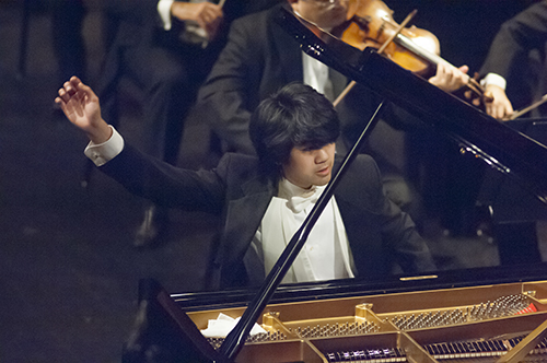 Sean Chen, from the U.S., performs Beethoven's Piano Concerto No. 5 in E-flat Major op. 73 during the Fourteenth Van Cliburn International Piano Competition in Fort Worth, Texas on June 7, 2013. ©2013 Robert W. Hart