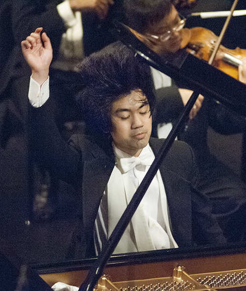 Sean Chen throws his head back near the end of his performance of Rachmaninov's Piano Concerto No. 3 in D Minor, op 30 during the Fourteenth Van Cliburn International Piano Competition in Fort Worth, Texas on June 9, 2013. ©2013 Robert W. Hart