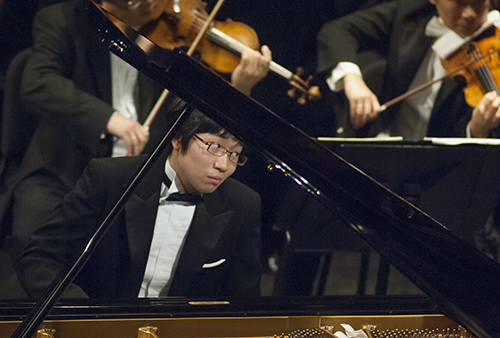 Japanese pianist Tomoki Sakata performs Mozart's Piano Concerton No. 20 in D Minor during the Fourteenth Van Cliburn International Piano Competition in Fort Worth, Texas on June 7, 2013. ©2013 Robert W. Hart