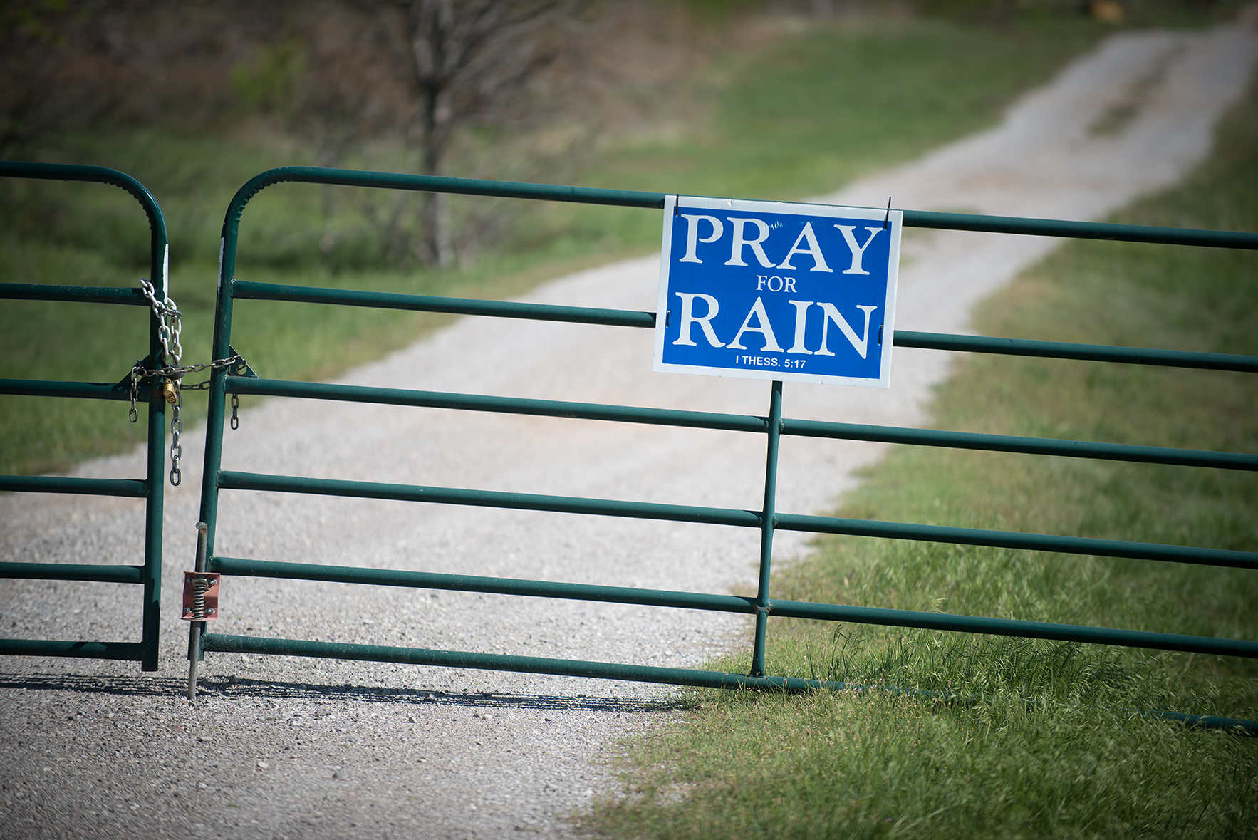 A sign encouraging passersby to pray for rain is attached to a ranch gate on Highway 1954 just south of Wichita Falls, Texas where the area is dealing with severe drought conditions. Measures are underway in Wichita Falls to convert waste water into drinking water. Some residents say they'll pass on wastewater. ©2014 Robert W. Hart