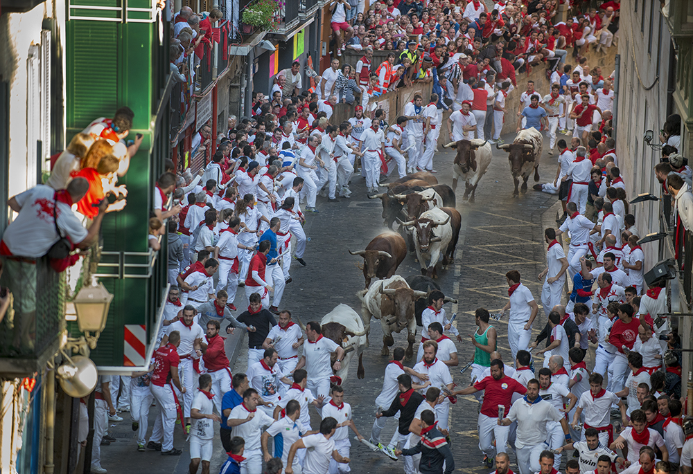 Men running with, and from, the bulls of Pamplona, Spain during the Festival of San Fermin on July 10, 2015. ©2015 Robert W. Hart
